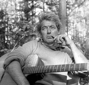 Quebec singer-song writer and poet Félix Leclerc with his guitar in 1957.